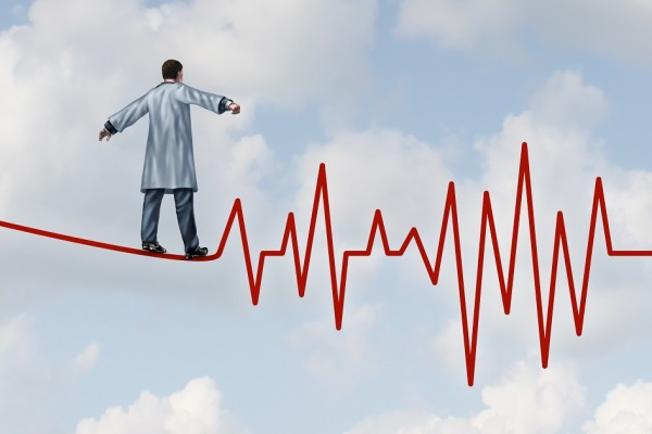 Doctor diagnosis danger and risk as a medical concept and health care metaphor with a physician in a lab coat walking on a tightrope or high wire shaped as an ECG pulse trace as a symbol of  monitoring patient health safely and carefully.